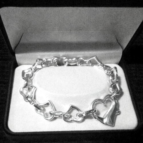 Sterling Silver bracelet Heart links design.