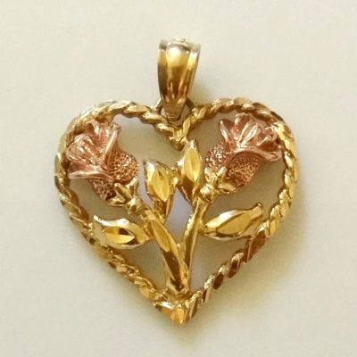 14kt yellow gold heart rose gold Roses pendant.